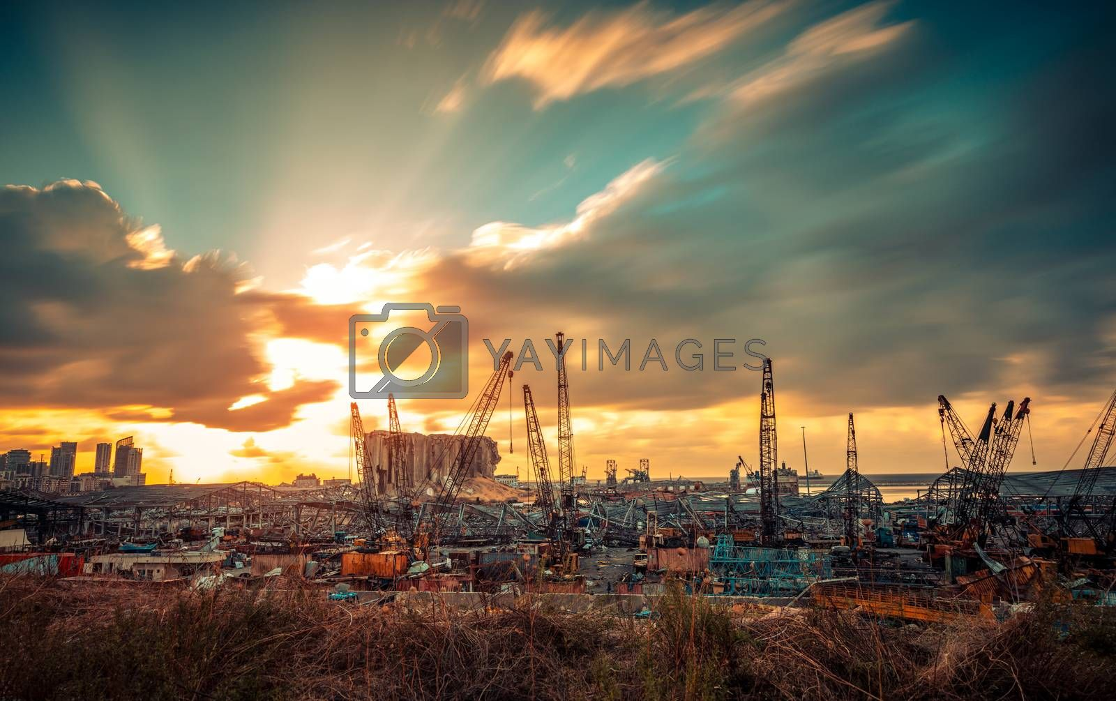 Dramatic Landscape of Ruins After Beirut Explosion. Beautiful Orange Sunset over the Rubble after a Terrible Disaster Blast in Lebanon.