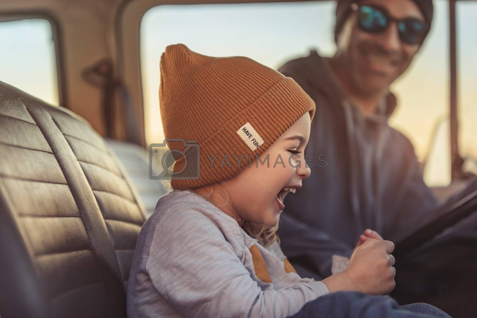 Father with his Little Baby Boy in the Car. Enjoying Road Trip Adventures. Active People. Laughing and with Pleasure Spending Time Together. Happy Family Life.