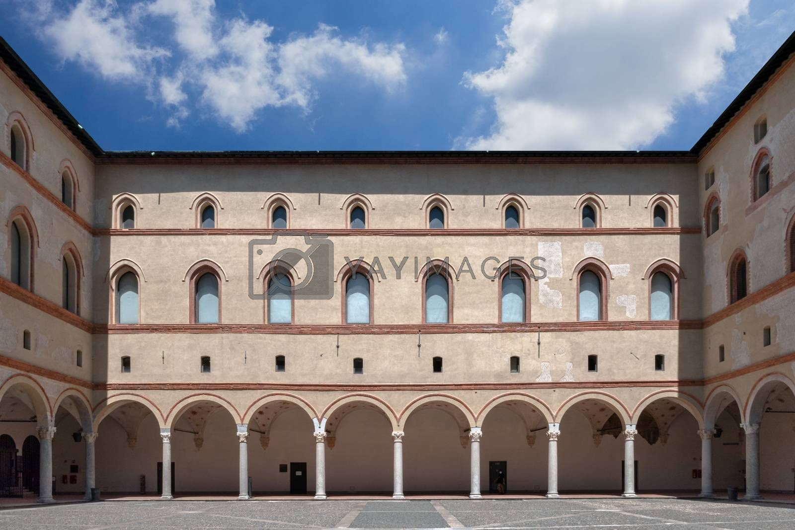 View from internal court to walls and arcades of ancient medieval fortress Rocchetta inside the Sforza castle. Milan, ITALY - July 7, 2020.