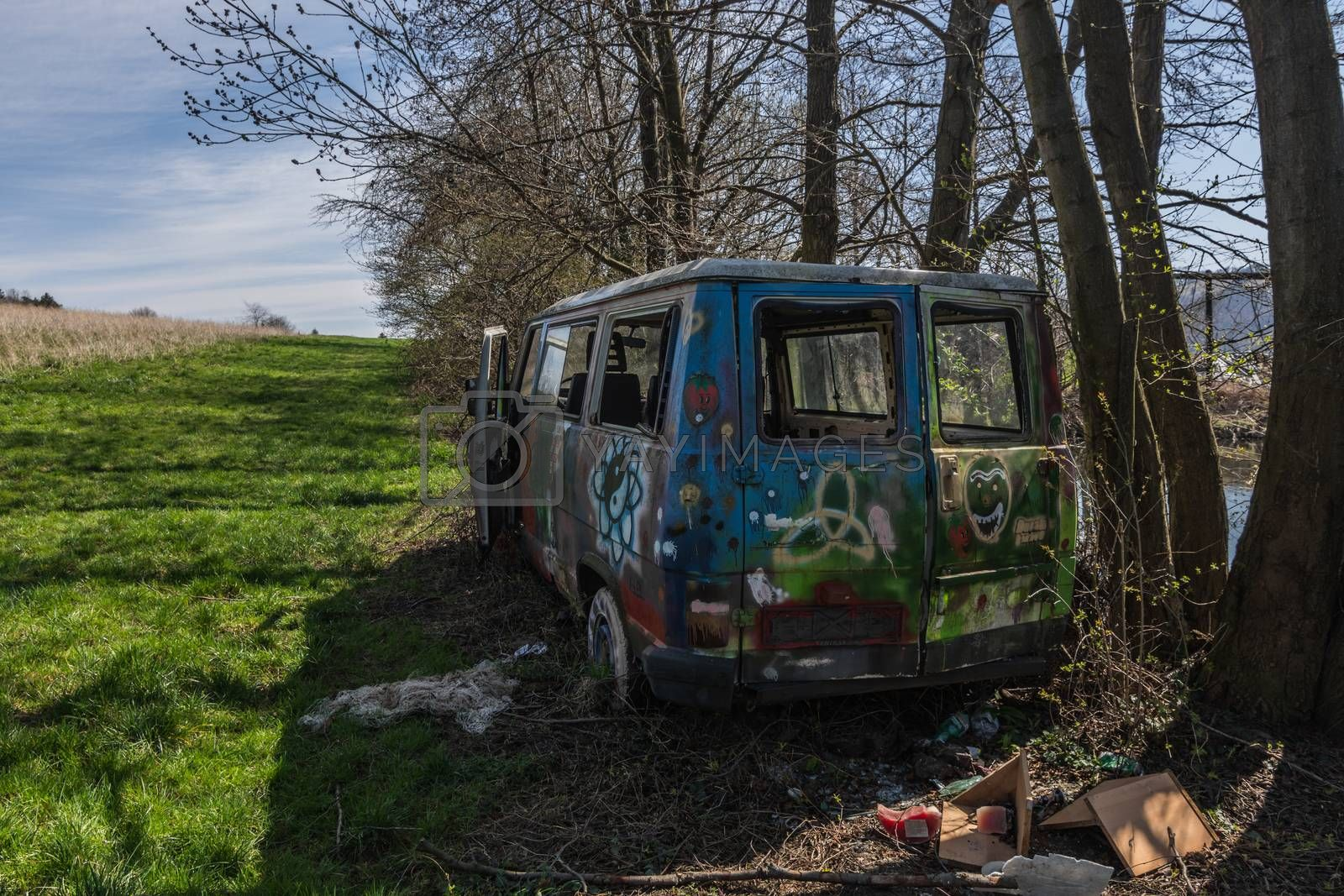colorful painted box cars from the back in nature