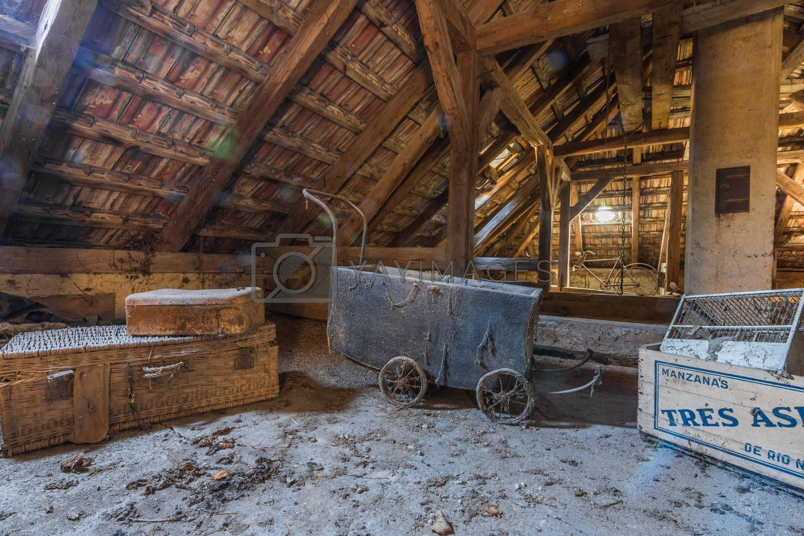 Old pram and boxes on a loft of a house