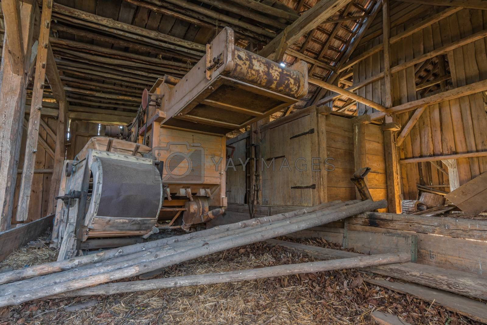 Old threshing machine in an abandoned house
