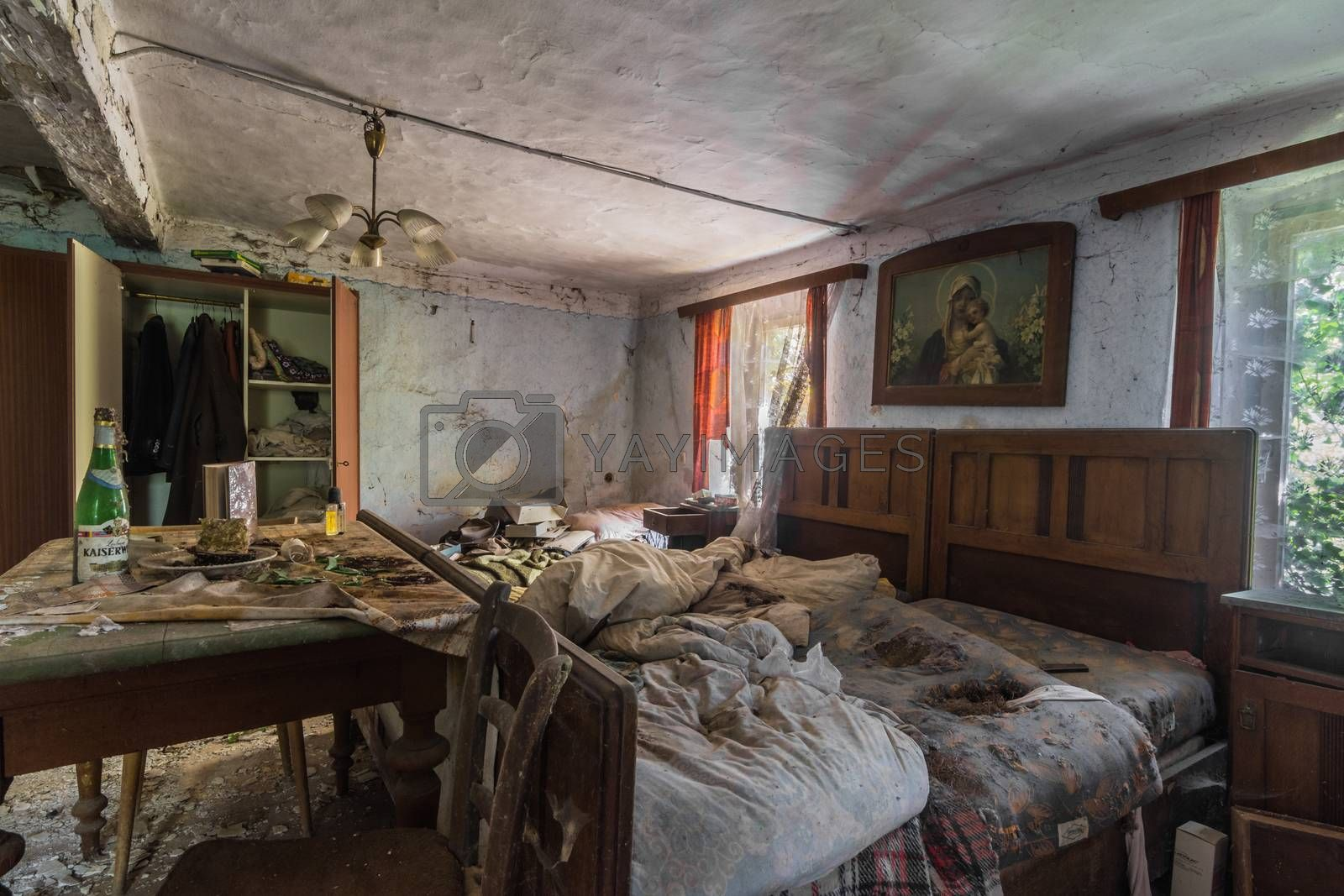 bed with picture and table in a room in a house