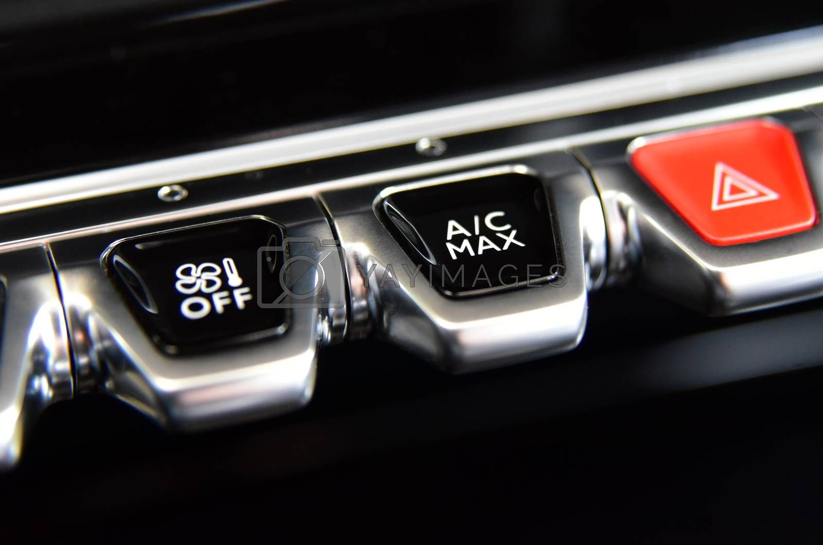 Royalty free image of Buttons for activating the air conditioners on the dashboard passenger car by aselsa