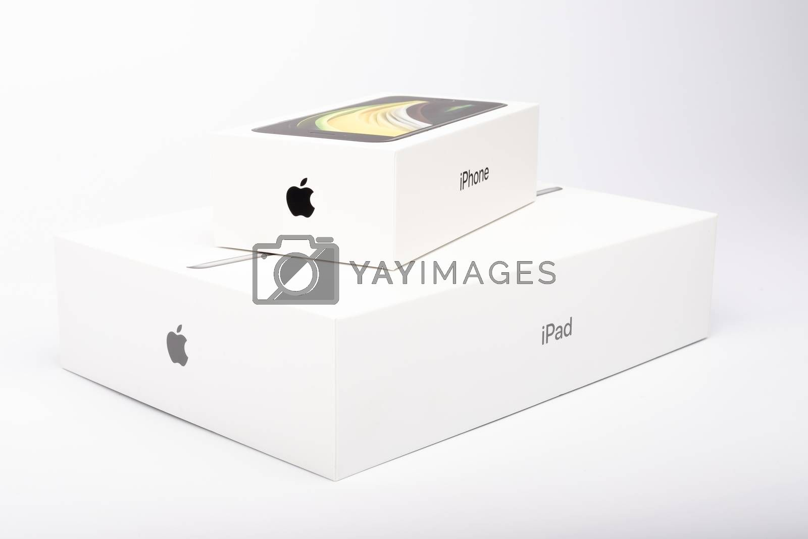 Paris, France - May 14, 2020: packaging of the new black iPhone SE 2020 and iPad from the multinational company Apple during the days of its studio release on a white background