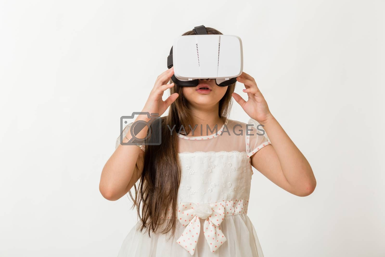 Young girl wearing virtual reality VR goggles