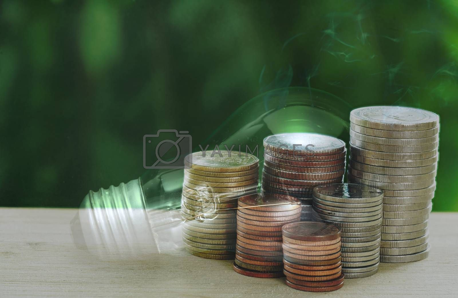 Abstract concept of stacked coins for income, expenses, electricity and utilities, finance and savings.