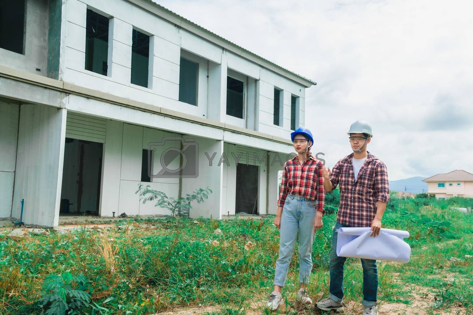 Young asian couple foreman engineering home inspection building  by oatzpenzstudio