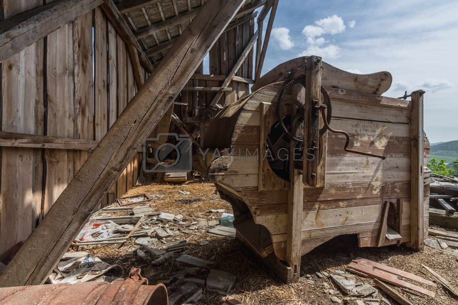 Old wooden thresher in an attic of an abandoned house