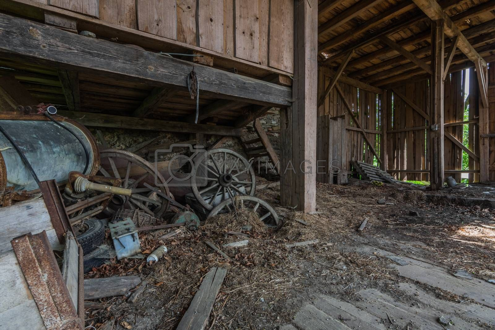 Wooden wagon wheels on an old abandoned farm