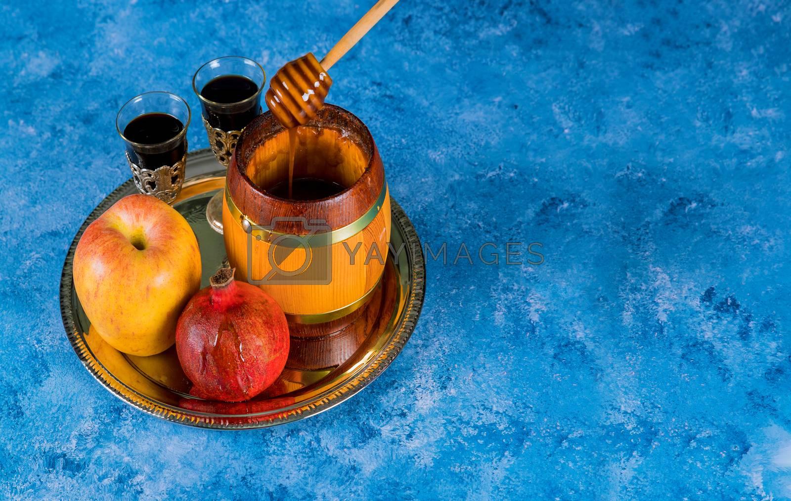 Rosh hashanah with glass honey jar and fresh ripe apples. Jewesh new year symbols