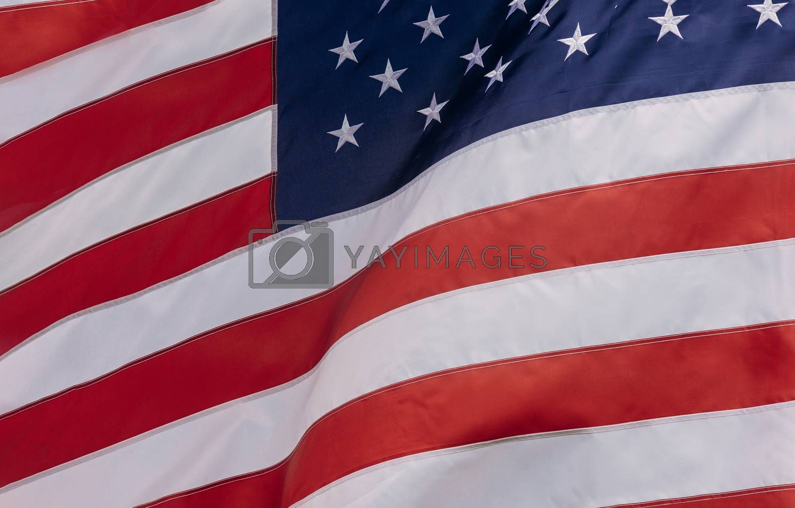 Royalty free image of American Flag flowing with waving in the wind by ungvar