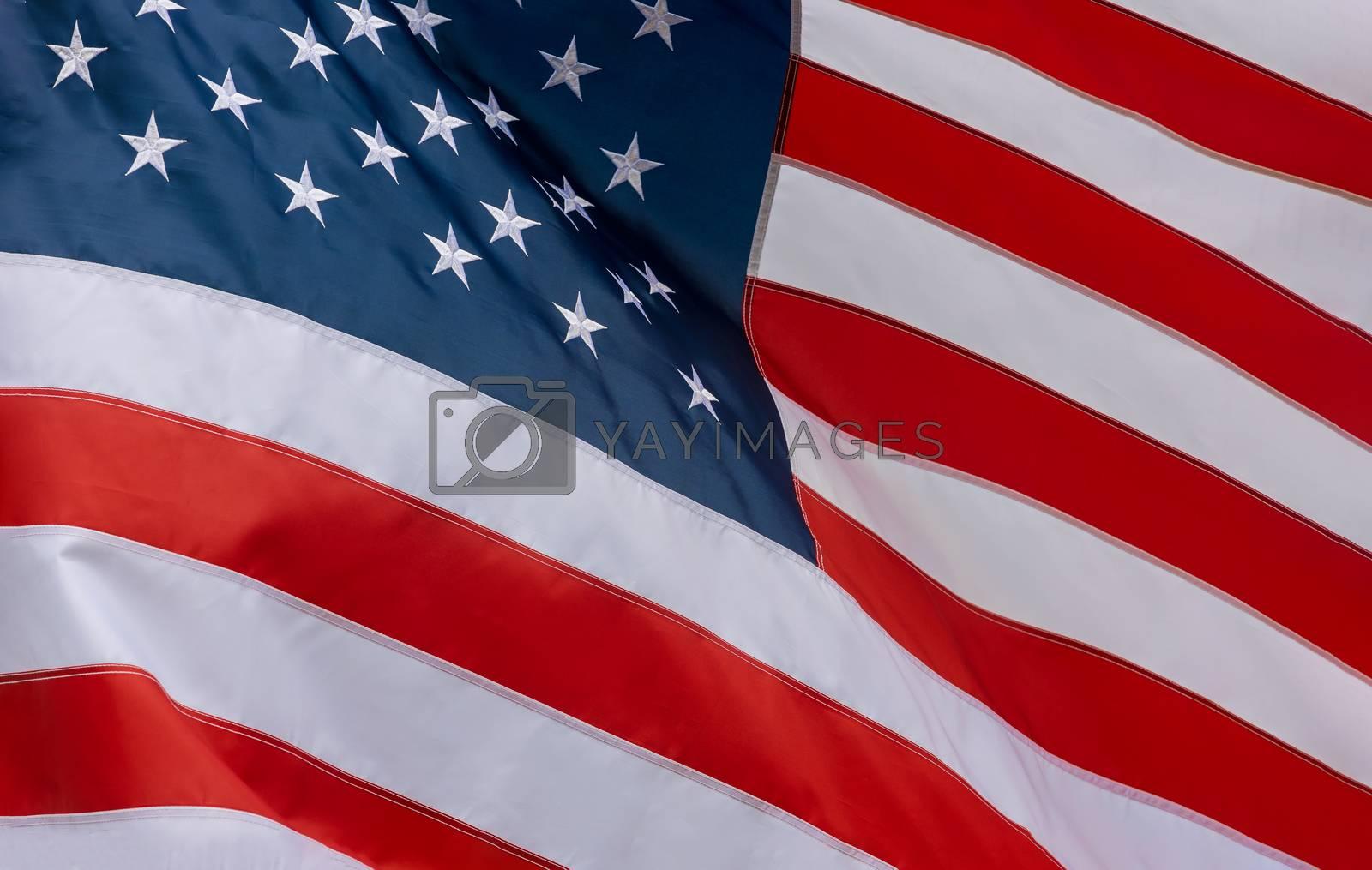 Closeup of ruffled American flag waving in the wind