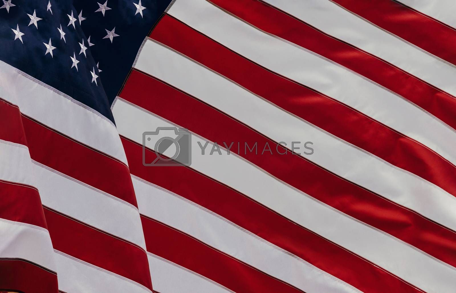 Royalty free image of Beautifully waving star and striped American flag by ungvar