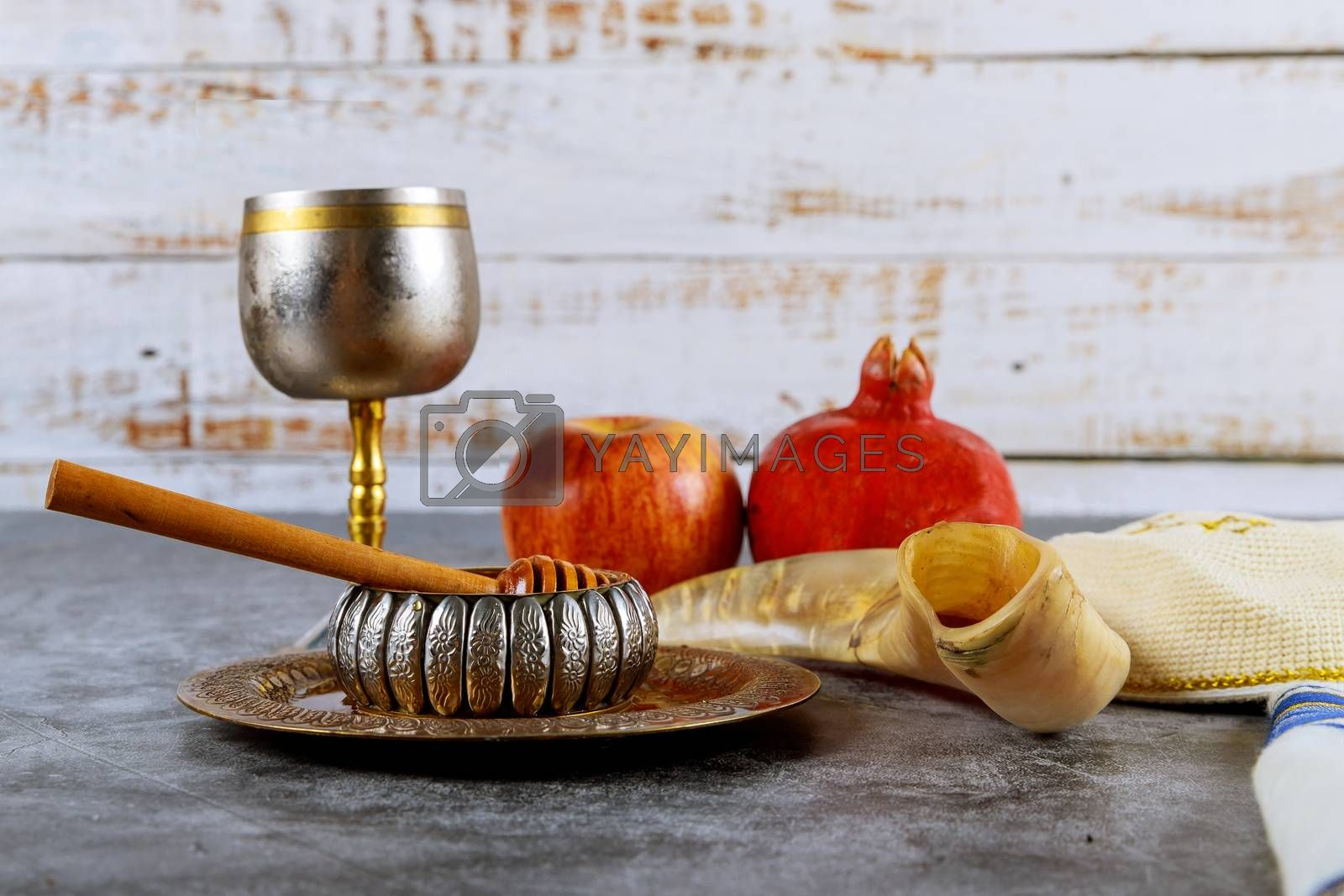 Jewish new year symbol Rosh hashanah with glass honey jar and fresh ripe apples.