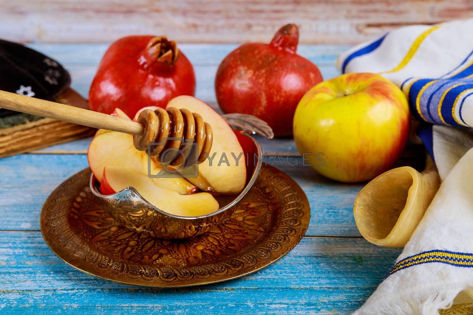 Orthodox Jewish holiday honey on the pomegranate and apples. Jewish new year Rosh HaShana shofar
