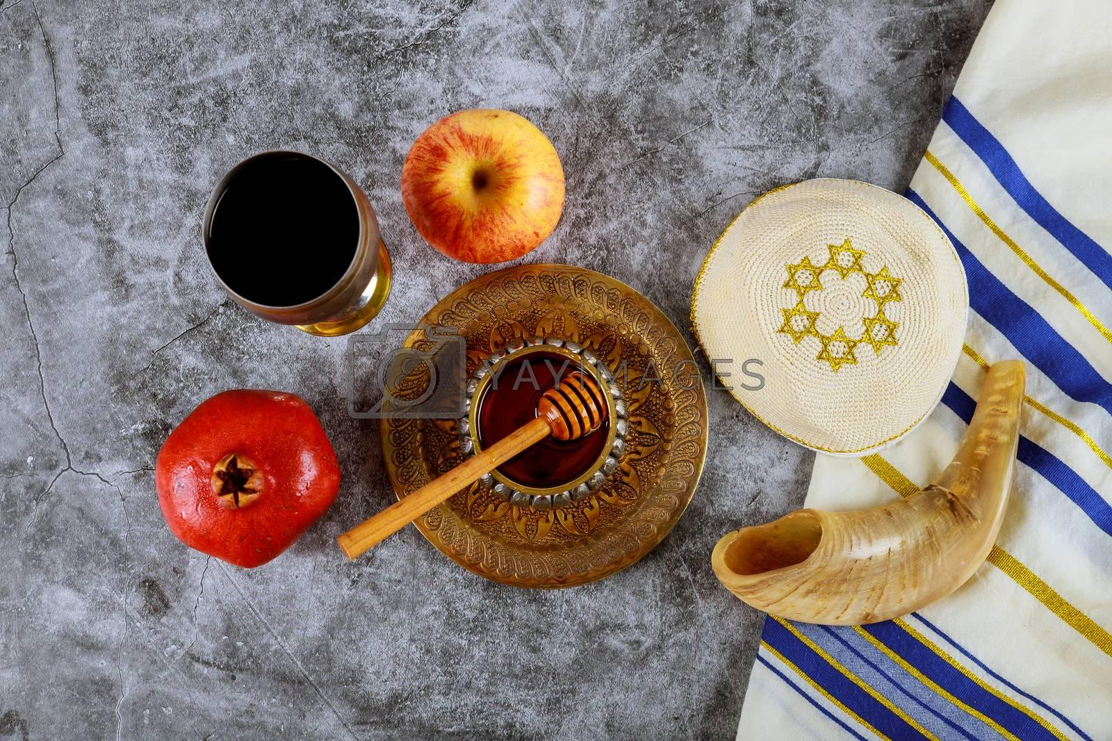 Rosh hashanah with glass honey jar and fresh ripe apples. Jewish new year symbols shofar and tallit