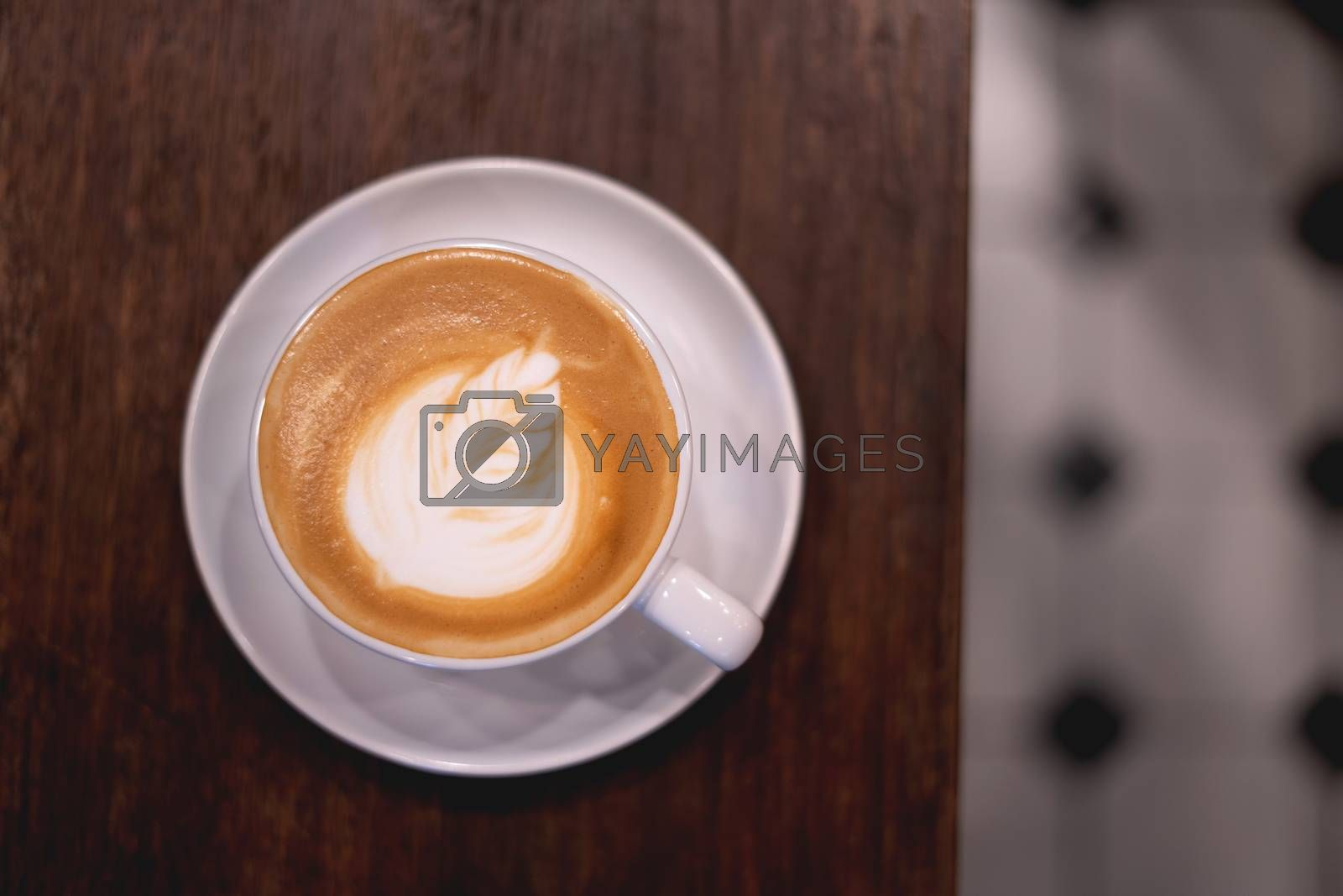 coffee on the wooden table from above. Urban coffee shop workspace or coffee break in morning