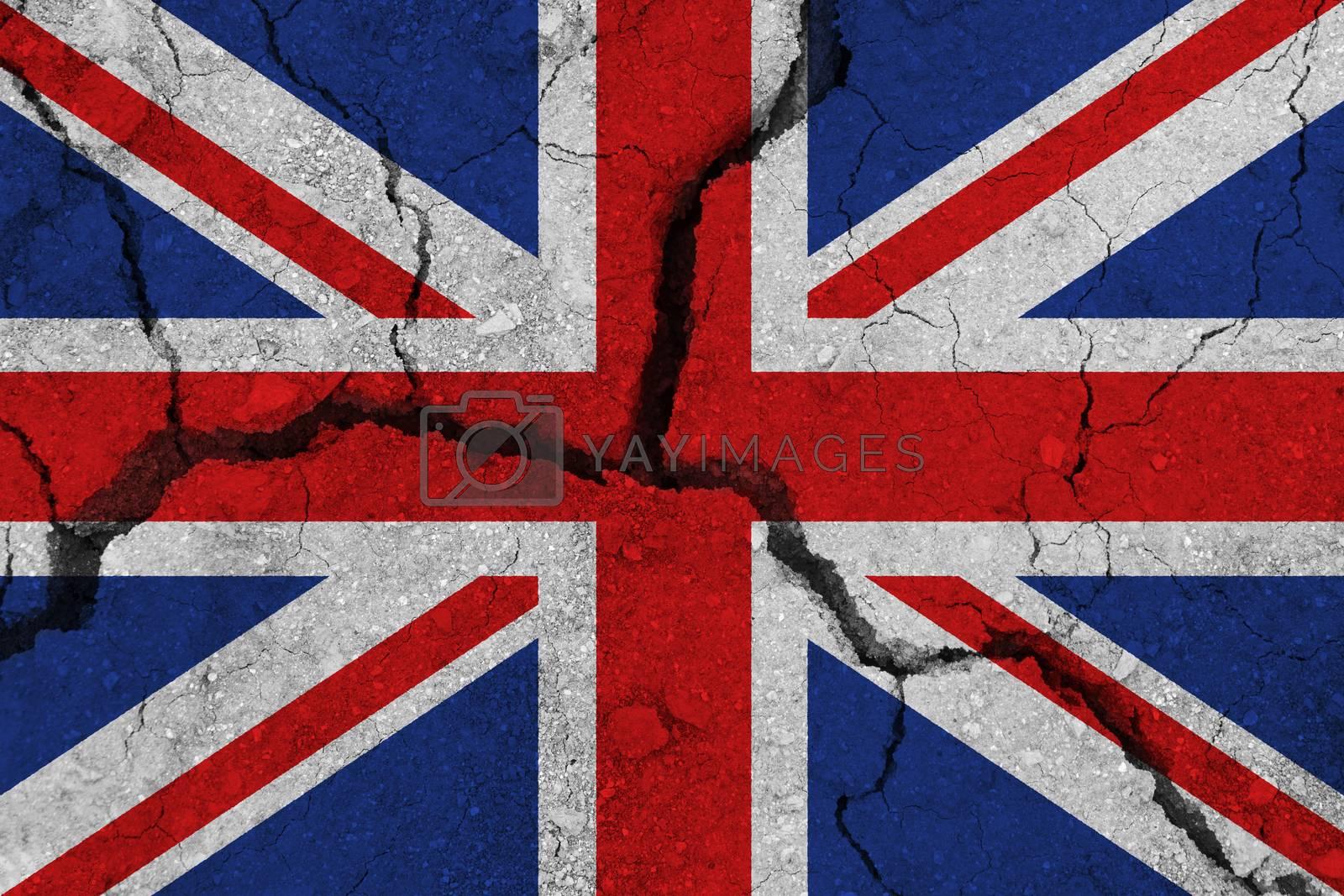 United Kingdom flag on the cracked earth. National flag of United Kingdom. Earthquake or drought concept
