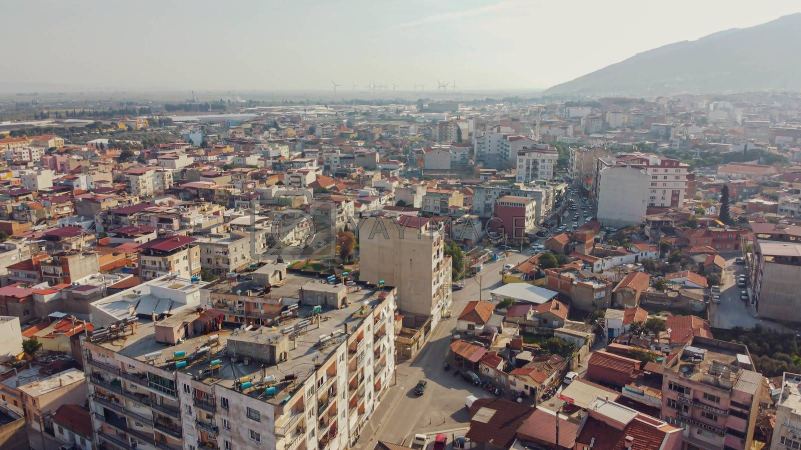 an aerial shoot with pale colors of a little town - there is many buildings. photo has taken at aydin/turkey.