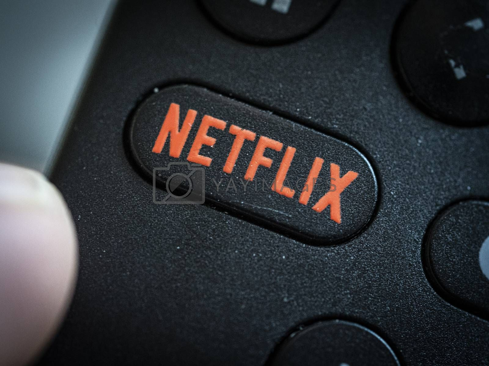 Extreme close up on Netflix remote control tv button