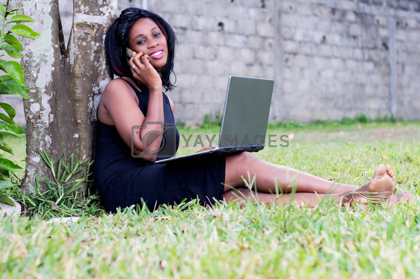 woman in communication working with laptop in the park