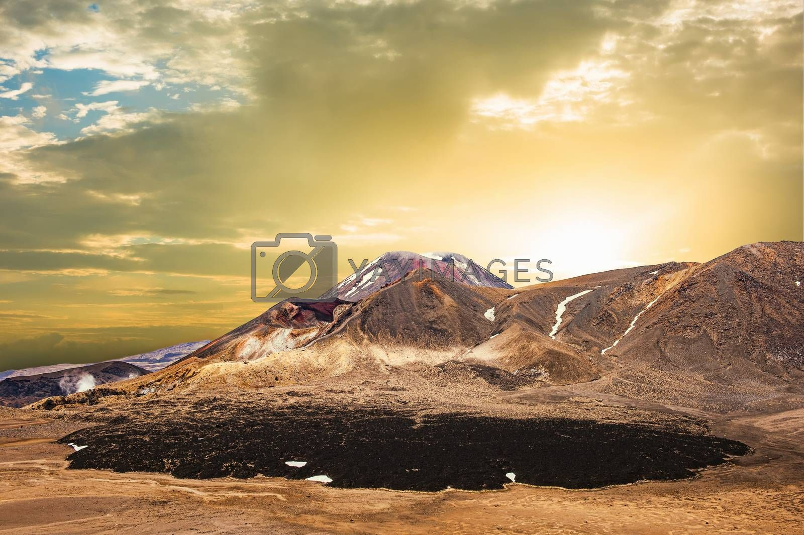 Sunset over Mount Ngauruhoe, a famous stratovolcano in a Tongariro national park, New Zealand