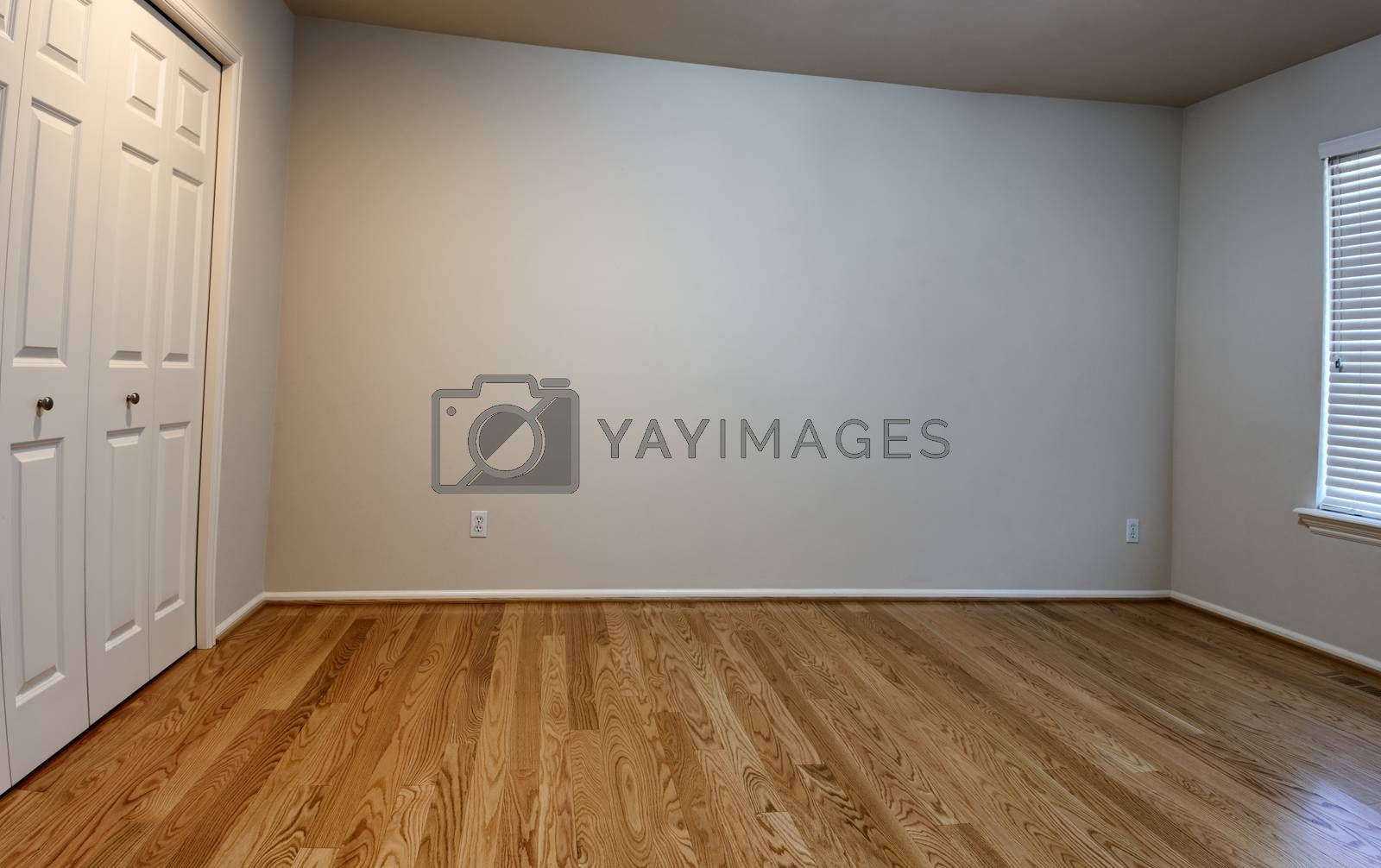 Newly installed red oak floor boards for bedroom in home