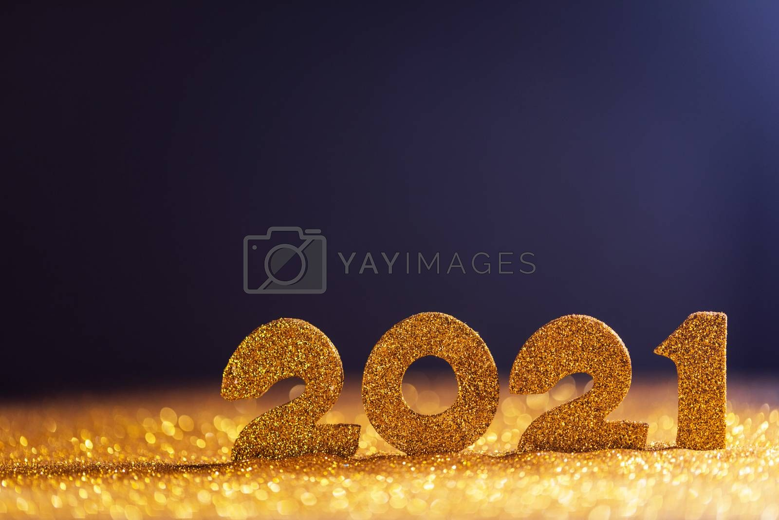 Happy new year 2021 celebration, glitter numbers on blue background