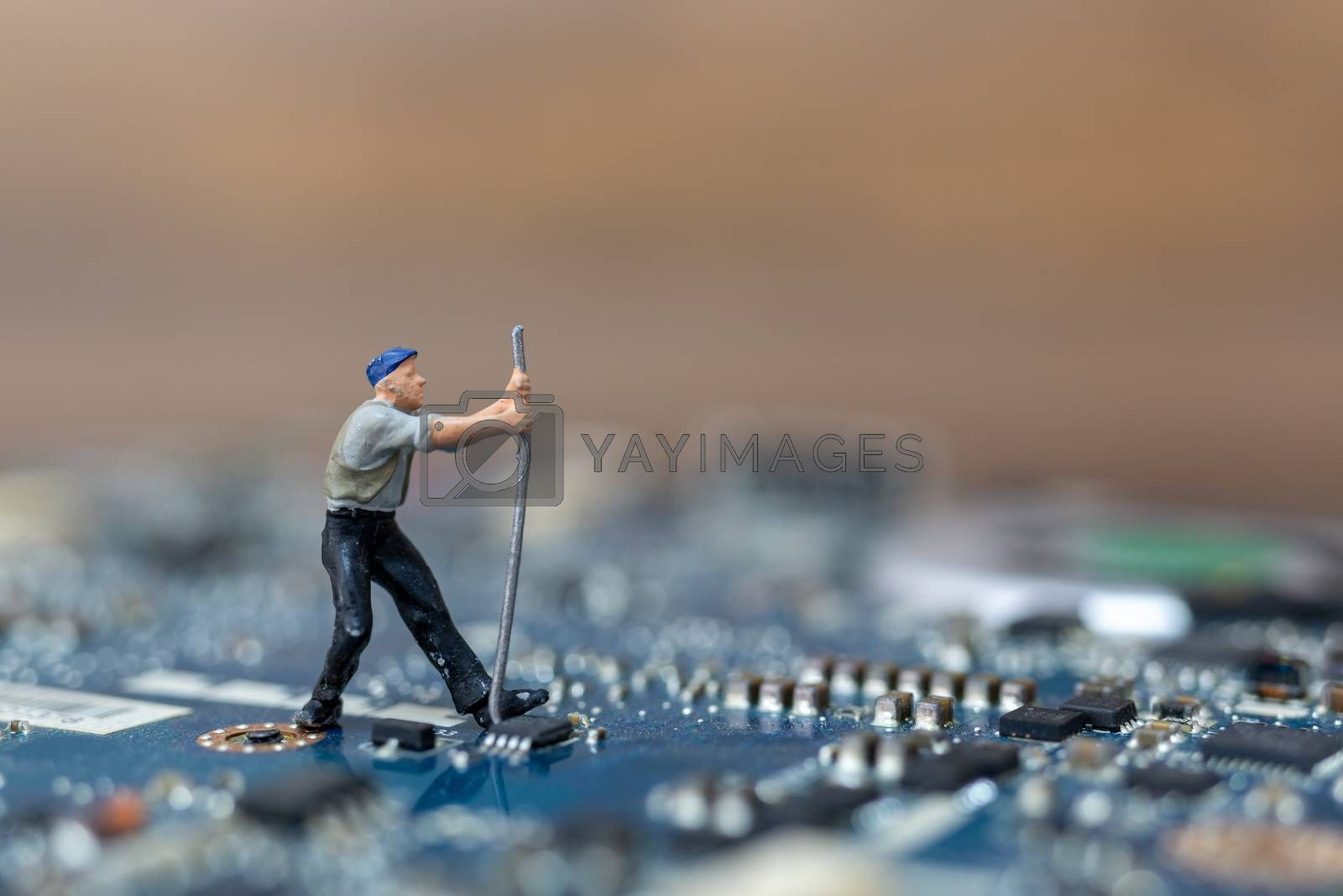 Miniature people working on cpu board, Technology concept