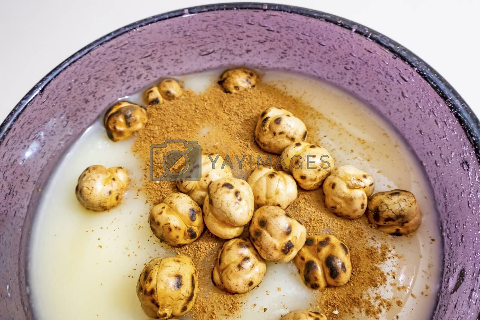 traditional turkish drink boza in glass with cinnamon powder and roasted chickpeas