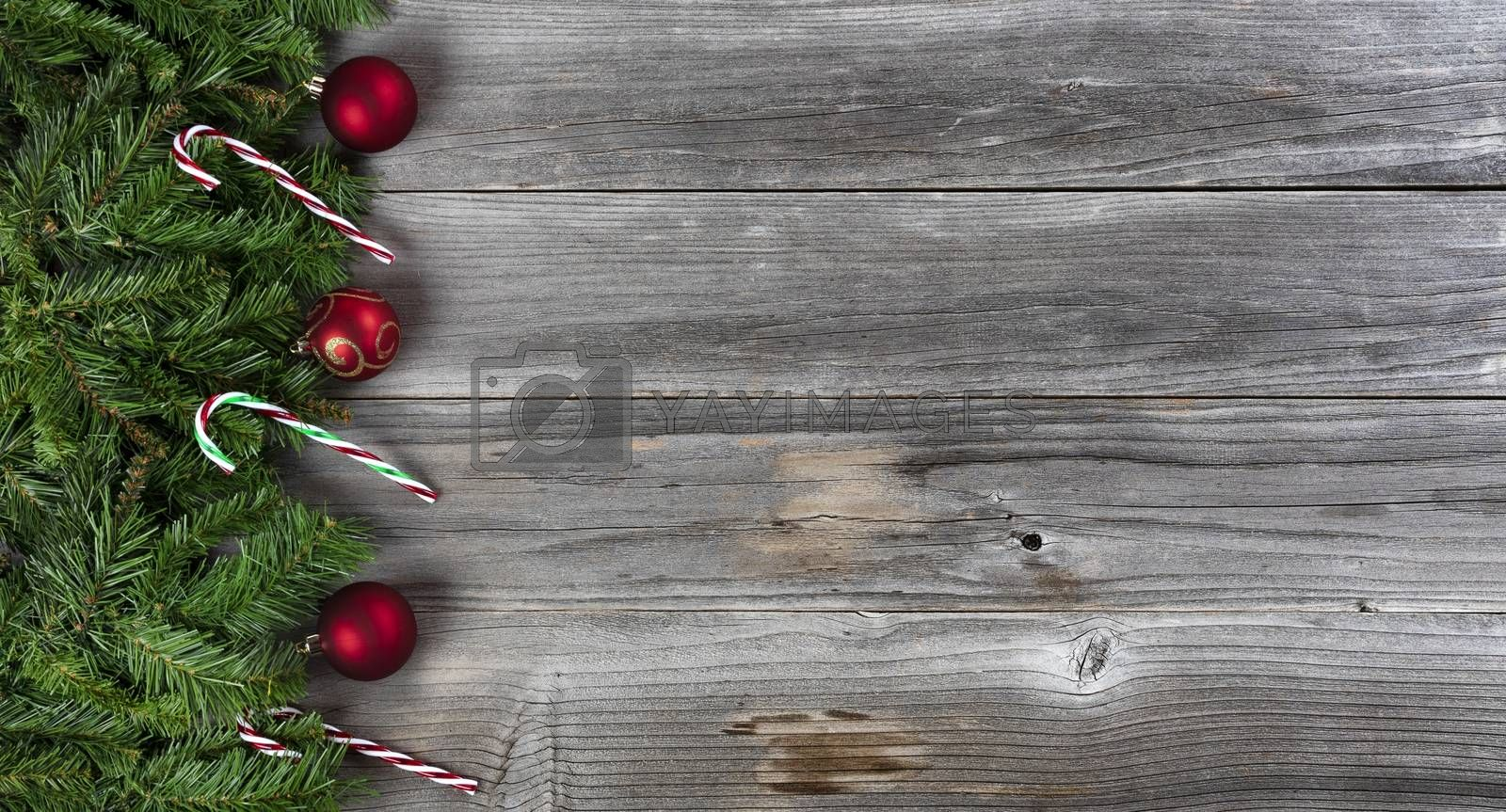 Merry Christmas and Happy New Year holiday concept with decorations on left side of weathered wooden boards