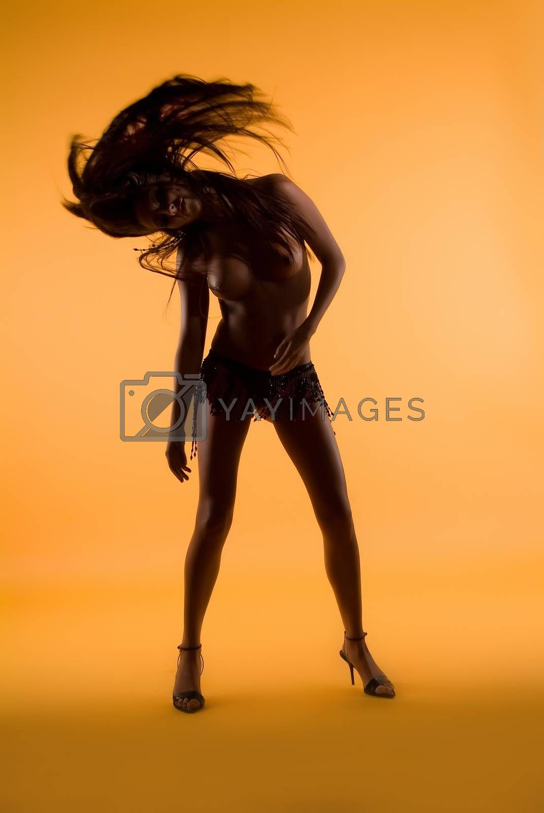 Young beautiful woman on a studio background
