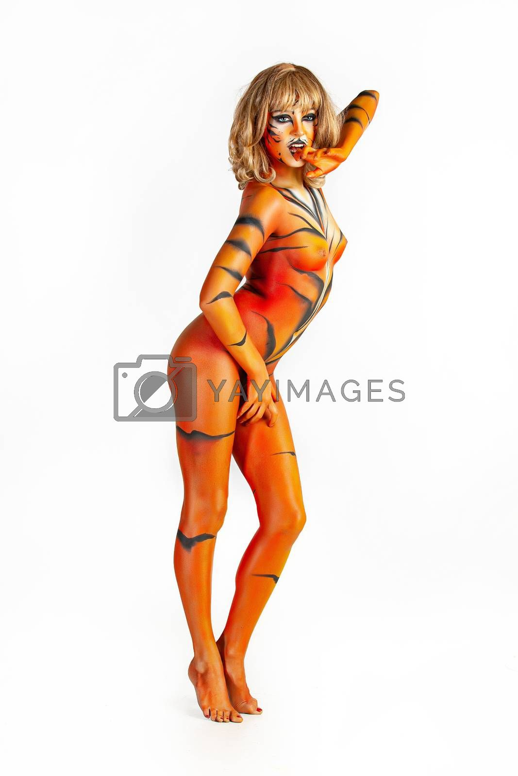 Young nude woman in a tiger body art