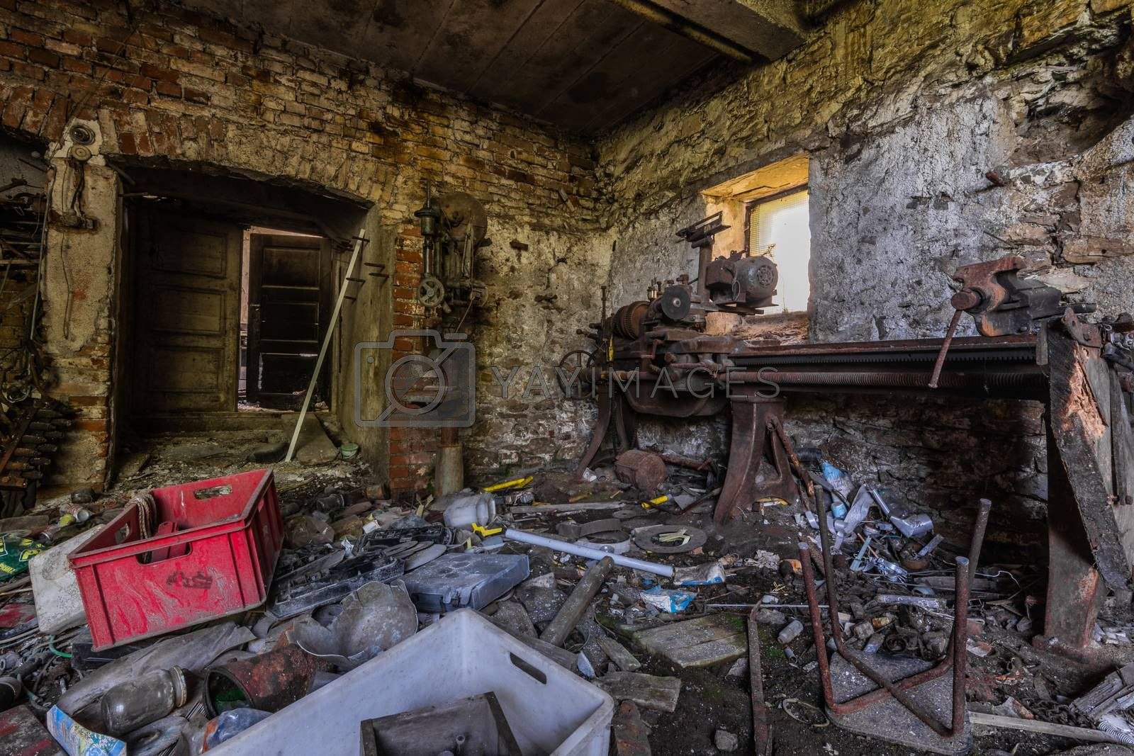 littered workshop from an abandoned farm