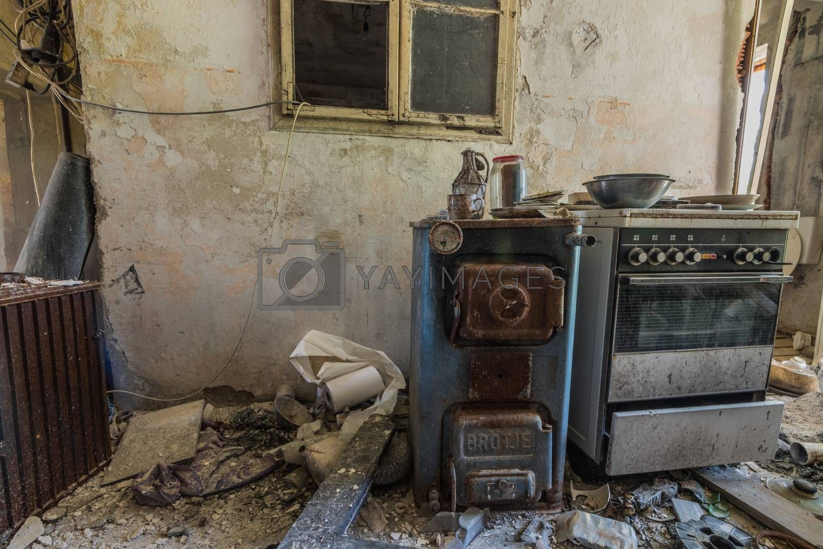 old ovens near a window in an abandoned house