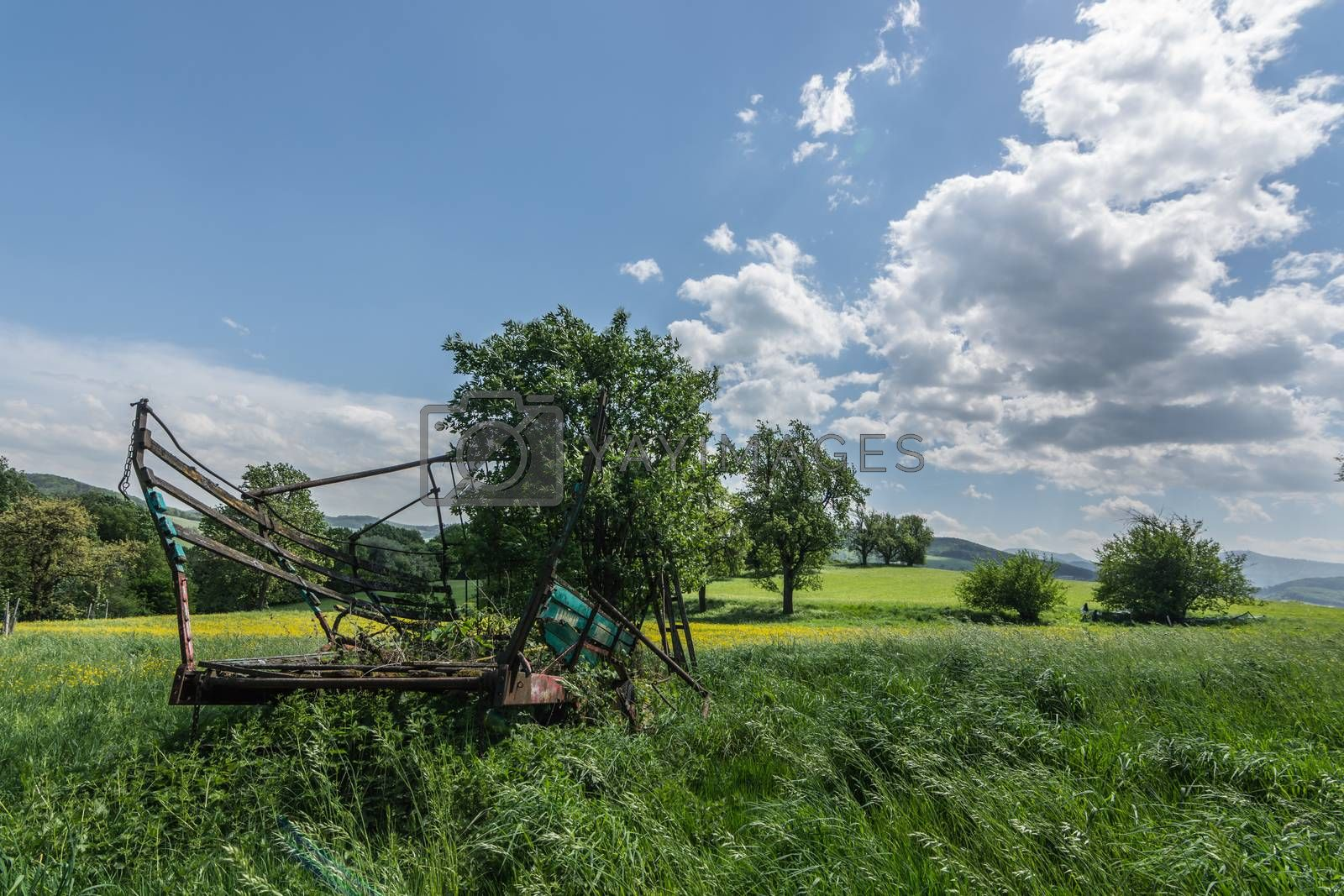 old wooden car in nature with sky and clouds