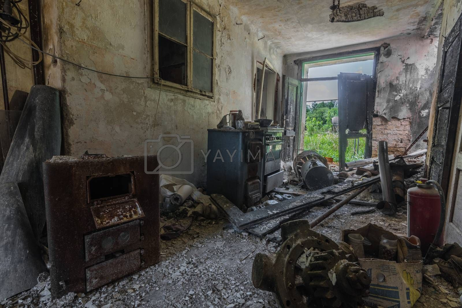 open room with objects in an old house