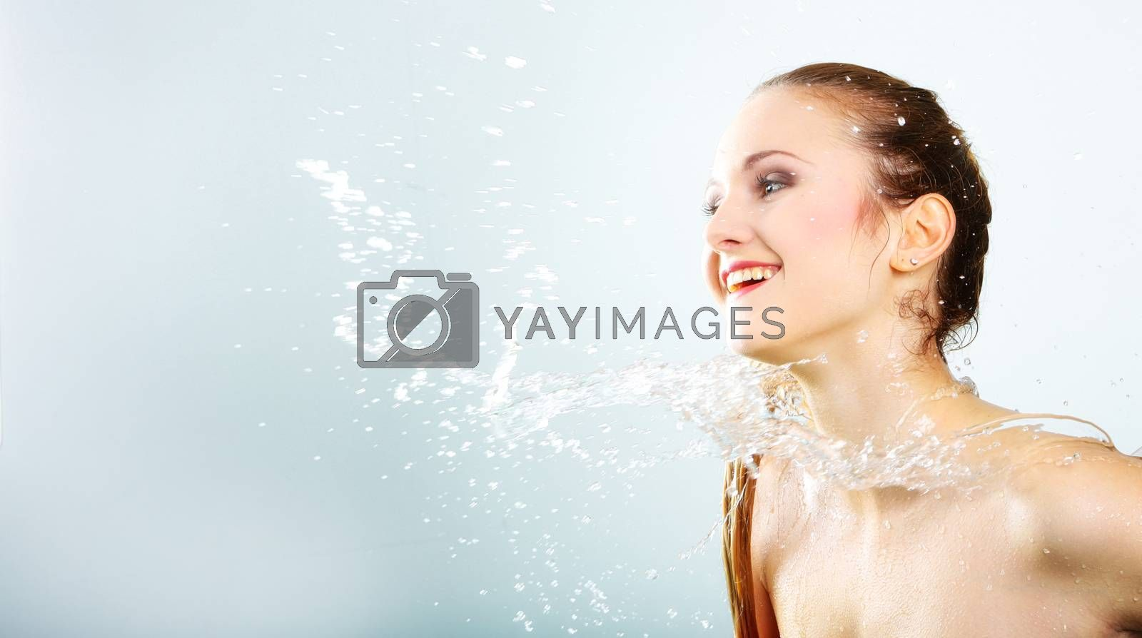 pretty woman with water splash. Beautiful model woman with a splash of water. Beautiful smiling girl underwater with fresh skin on blue background. Skin care, cleansing and moisturizing concept. Pretty face