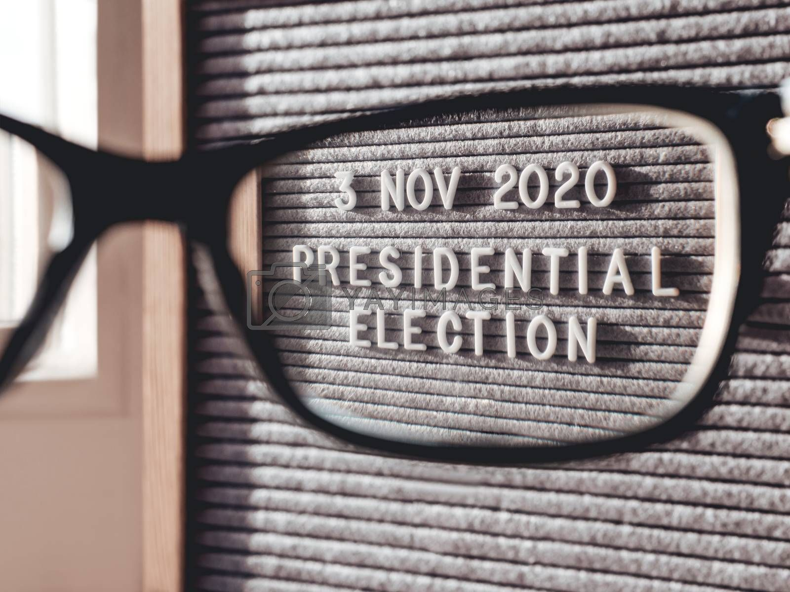 Announcement of USA Presidential Election at 3rd November 2020. Call to go to the vote. Closer view on letter board through eyeglasses.