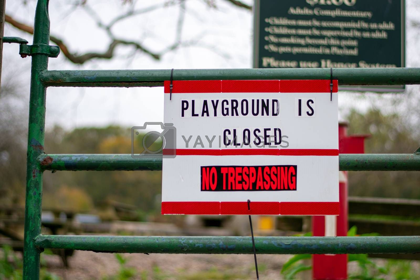 A Sign in Response to COVID-19 That Says the Playground is Closed and No Trespassing