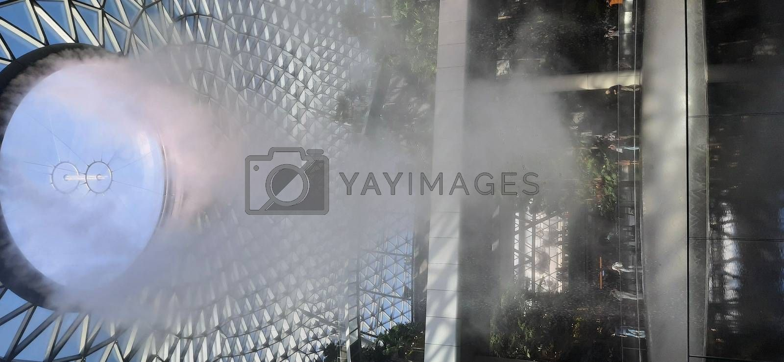 "Dust coming out of a steel glass roof waterfall at ""Jewel"" area, Terminal 1, Changi airport, Singapore on January 26, 2020"