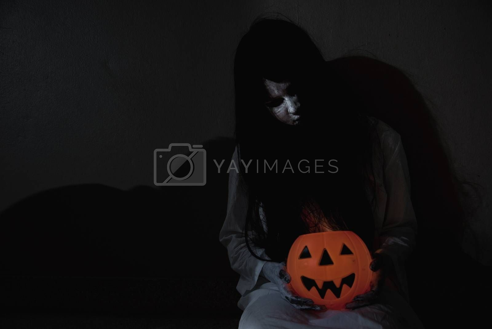 Woman ghost horror have hand holding her pumpkin, by Sorapop