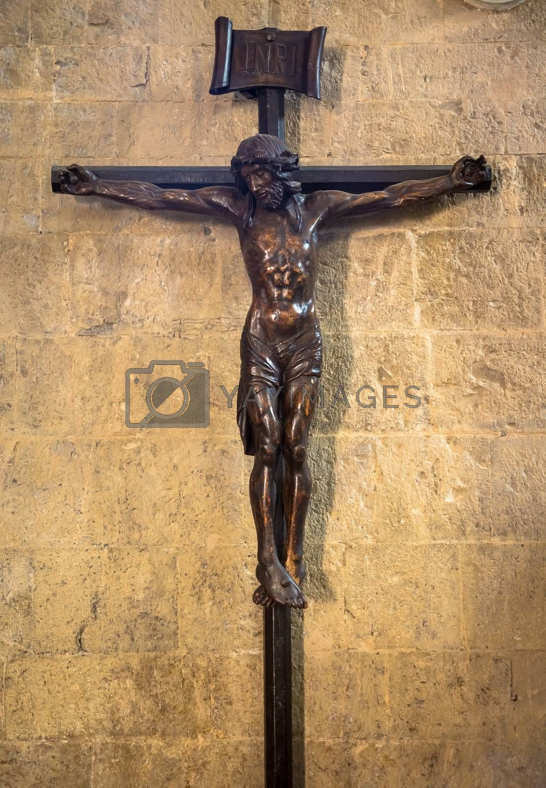 Old Italian crucifix, made of wood, with Jesus Christ symbol of resurrection and salvation