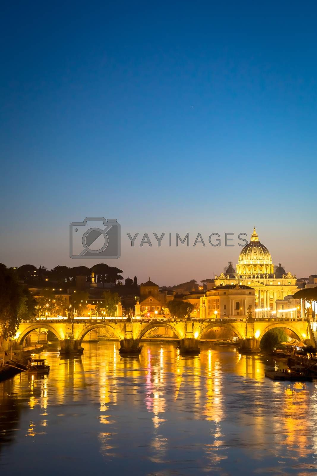 ROME, ITALY - JUNE 2020: sunset panorama on Tiber river bridge with Saint Peter Cathedral dome (Vatican City) in background - Rome, Italy