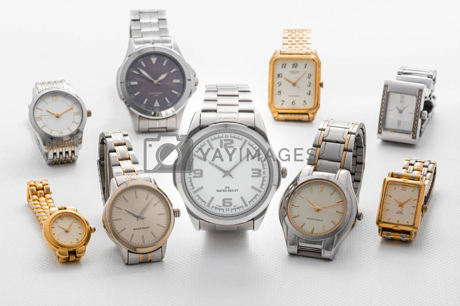 elegant and classic silver and gold wrist analog watches on white background for e-commerce