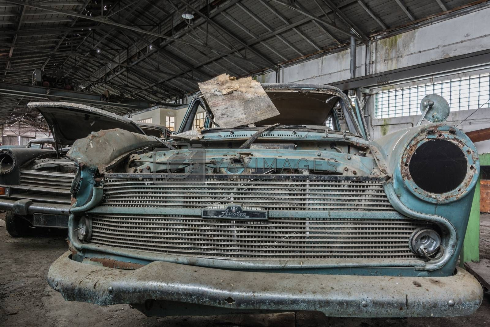 Old Morris Oxford front view in an abandoned car repair shop