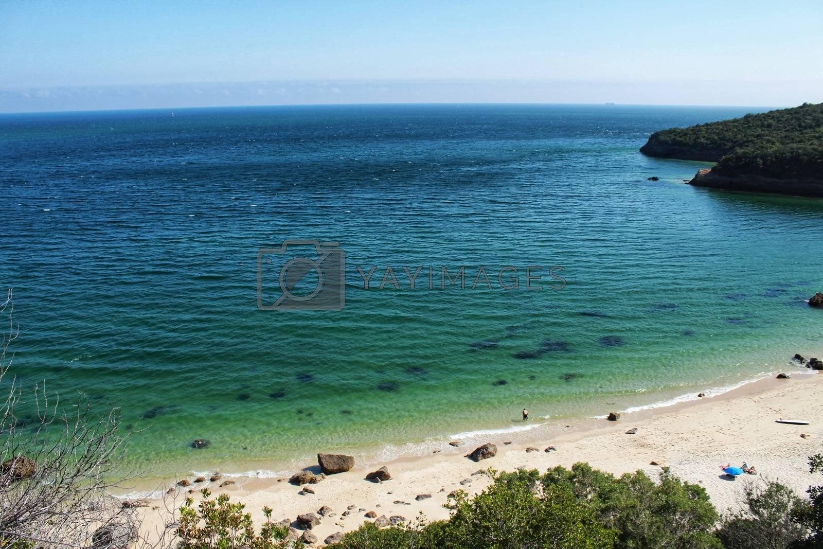 Crystalline waters of Galapinhos Beach between mountains in Portugal