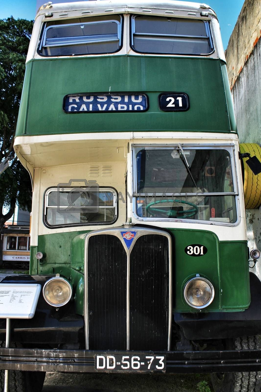 Lisbon, Portugal- June 15, 2018: Old and colorful green and orange passenger bus in a museum.
