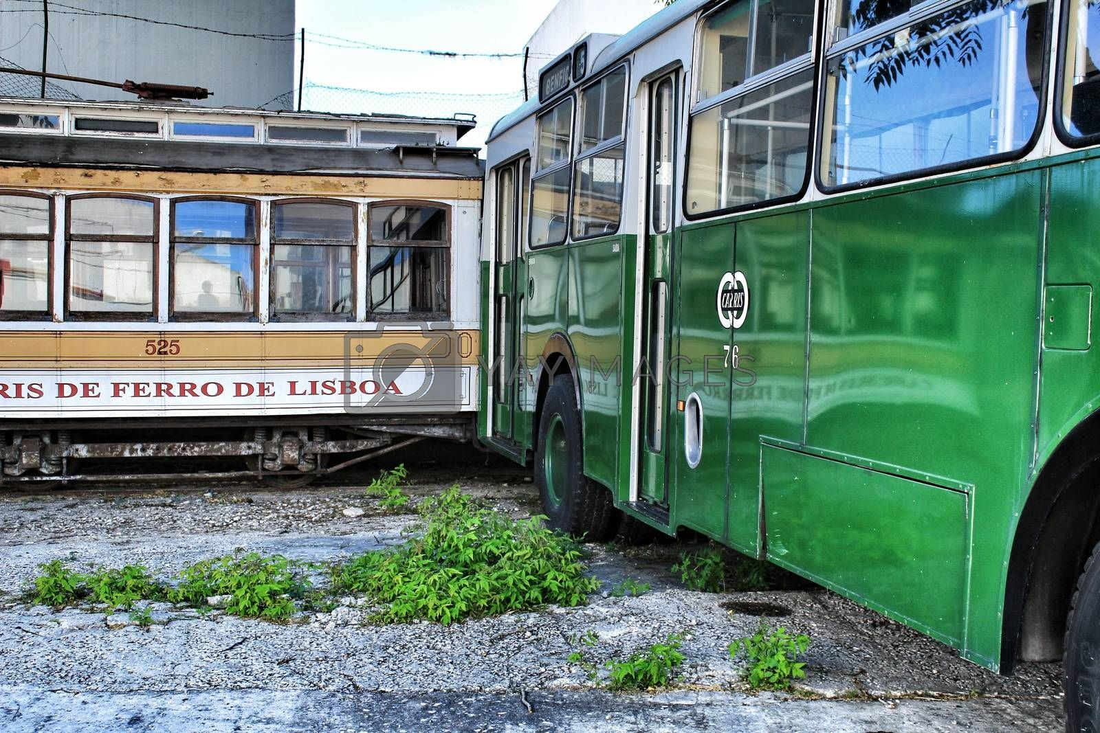 Lisbon, Portugal- June 15, 2018: Old and colorful passenger bus and vintage tram in a museum.
